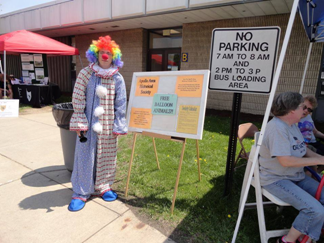 Cherry the clown helps at the AAHS Learning Festival Booth.